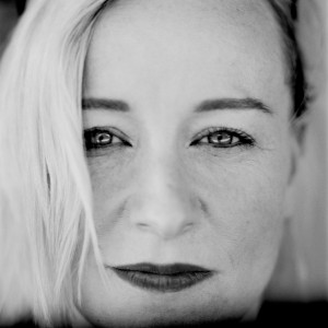 Face of Cathy Davey with make up.