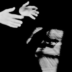 Hands of Eivind Gullberg Jensen with his shadow on the wooden floor.