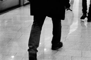 Emir Kusturica walking in the shopping centre.