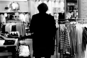 Emir Kusturica from the back in the boutique in shopping centre.