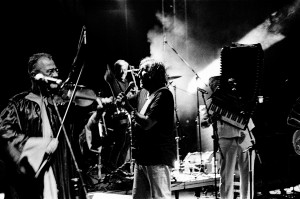 Emir Kusturica with violin player on the stage at the concert of No Smoking Orchestra.