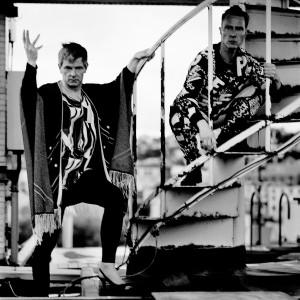 Gus Gus members Daniel Agust Haraldsson and Birgir Porarinsson posing on the stairs.