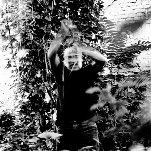 Jean-Marc Barr fighting plants in a jungle house.