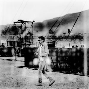 Jean-Michel Jarre walking in the dessert before his concert.