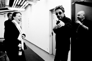 Jean-Michel Jarre pointing his finger to the camera in the backstage before his concert with his manager Fiona Commins and his tour manager Chris Rowley.