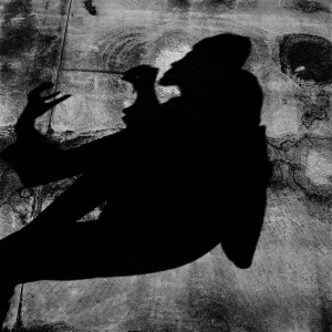 Shadow of Kevin Griffiths with his baton.