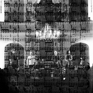 Double exposure of Kronos quartet members standing in front of the audience after their concert and the scores of their second violin player.