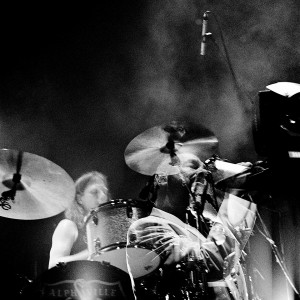 Double exposure of Marian Gold and the drummer on the stage at the concert of Alphaville.